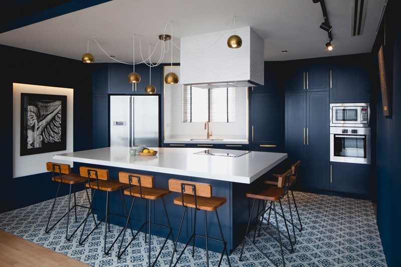 Photography By Beton Brut The Kitchen Has A Palette Of Saturated Blue Cabinets
