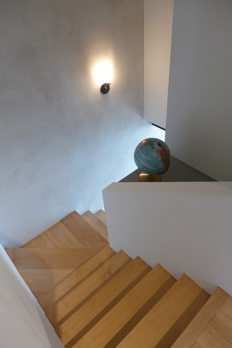 A modern apartment with wood stairs. #WoodStairs #ModernStairs
