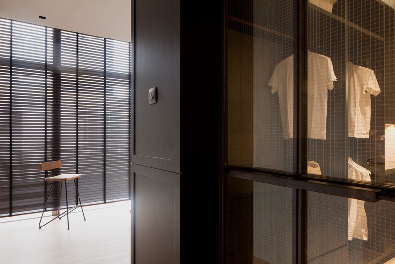 A modern apartment with a walk-in closet. #WalkInCloset #ModernApartment #InteriorDesign #ClosetDesign