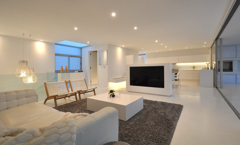 The use of white is a consistent theme throughout this home