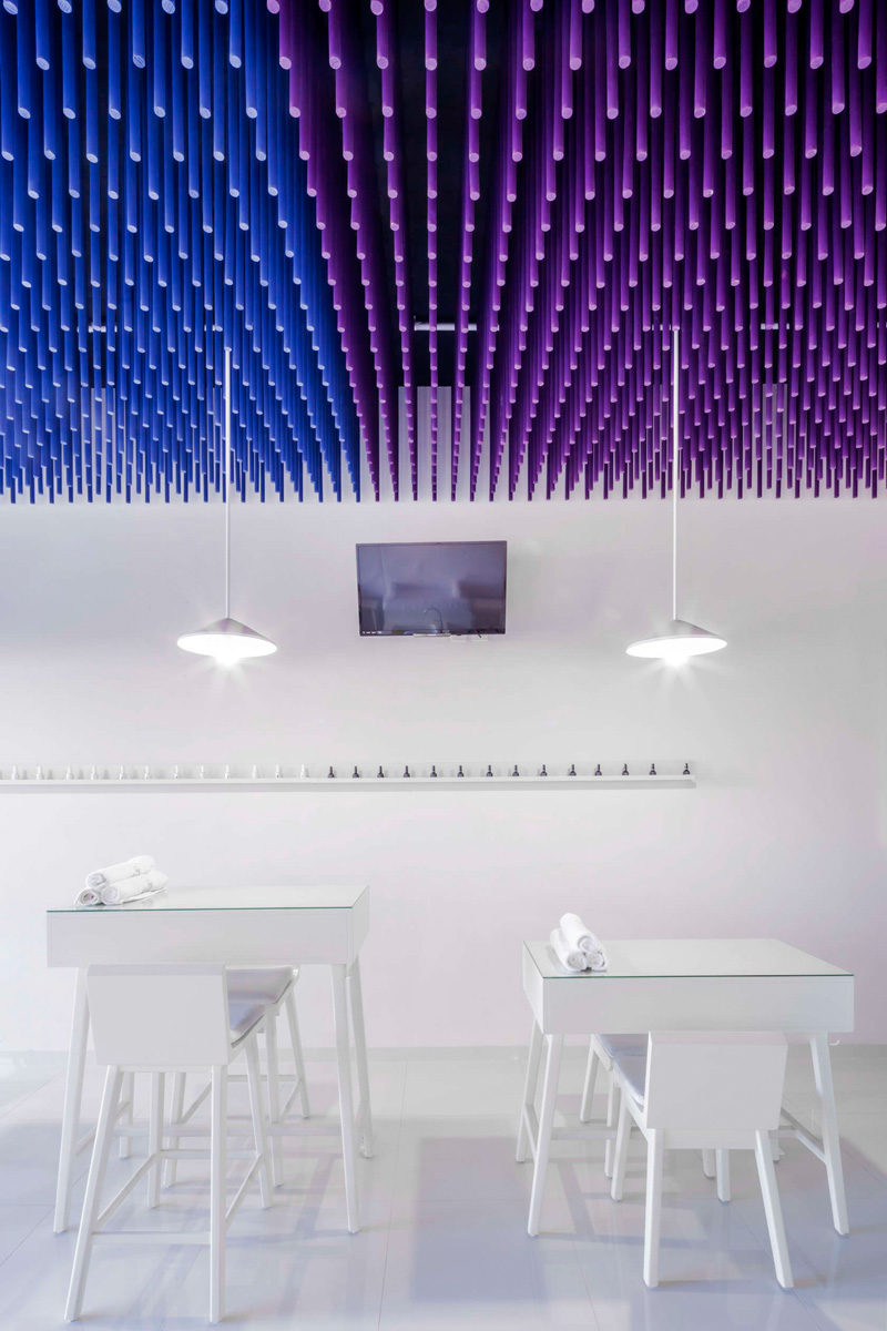 Colorful sticks hang from the ceiling of this nail salon