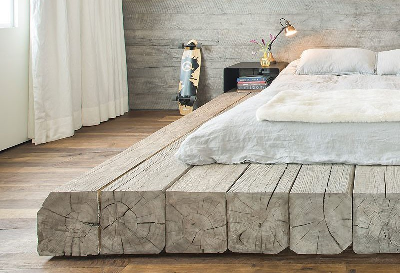 This bed platform has been made using reclaimed logs