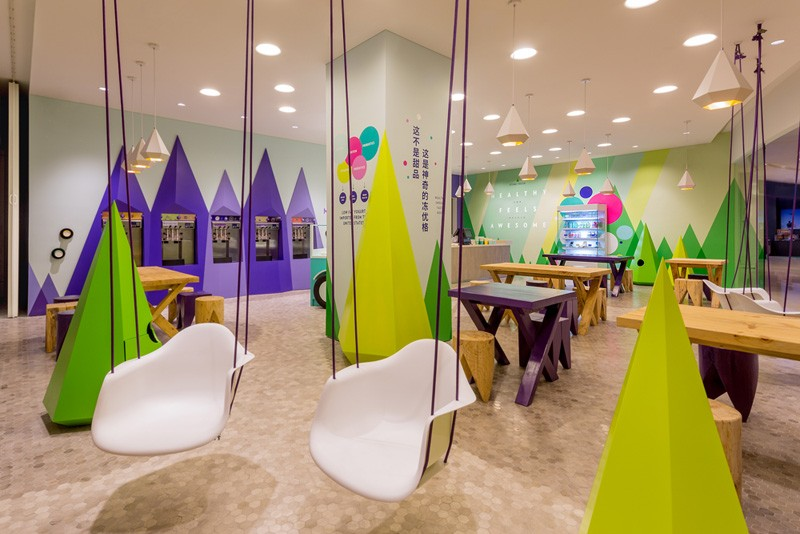 A playful theme of abstract trees and mountains were designed for this frozen yogurt shop