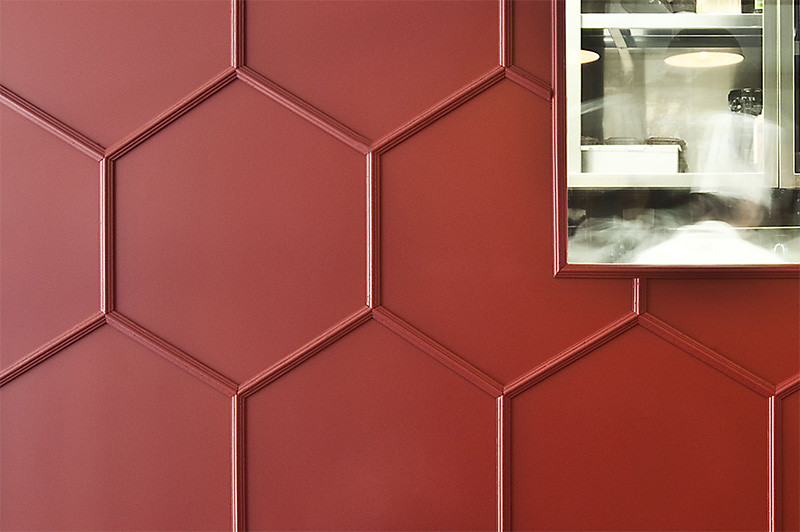Moulding was used to create a 3D honeycomb pattern on this restaurant's walls