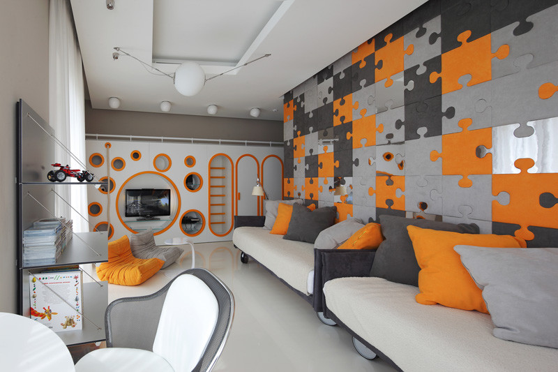 This children's bedroom has a fun custom-built, multi-functional wall unit