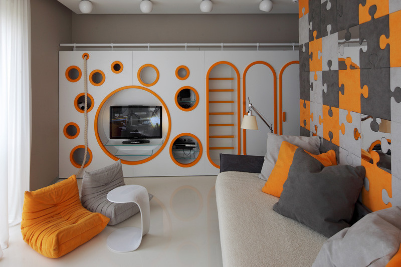 This colourful children's bedroom has a custom-built, multi-functional wall unit