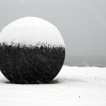 A burnt wood spherical sculpture has arrived on the shores of Lake Ontario