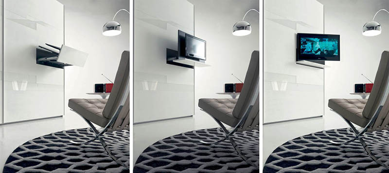 This television is hidden within a pullout tv-rack in the wardrobe