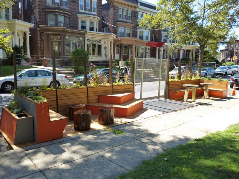 Logan CDC designed this parklet in Philadelphia, Pennsylvania with wood benches, bright colors and lots of plant life to keep the communal space fresh and natural.