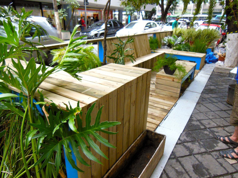 This wood parklet in Sao Paulo, Brazil is brimming with plant life and has pops of bright blue to attract people walking by and offer them a comfortable break from walking through the busy city.