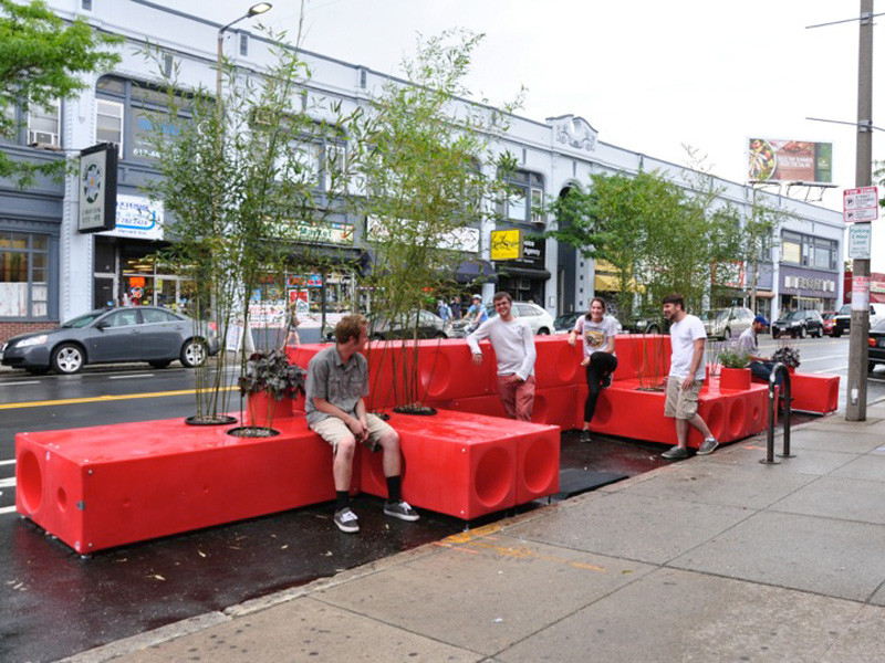 INTERBORO designed this bright red parklet in Boston, Massachusetts, that's modular blocks, made from a durable plastic, that can be stacked, arranged, and moved to unique configurations.
