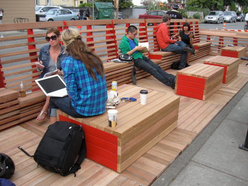 This wood parklet in Vancouver, Canada, is large enough for lots of people to enjoy it all at the same time and adds a fun pop of color to the concrete sidewalk.