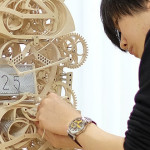 This Intricate Wood Clock Literally Writes The Time