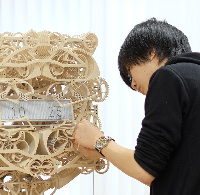 This Wooden Clock Literally Writes The Time