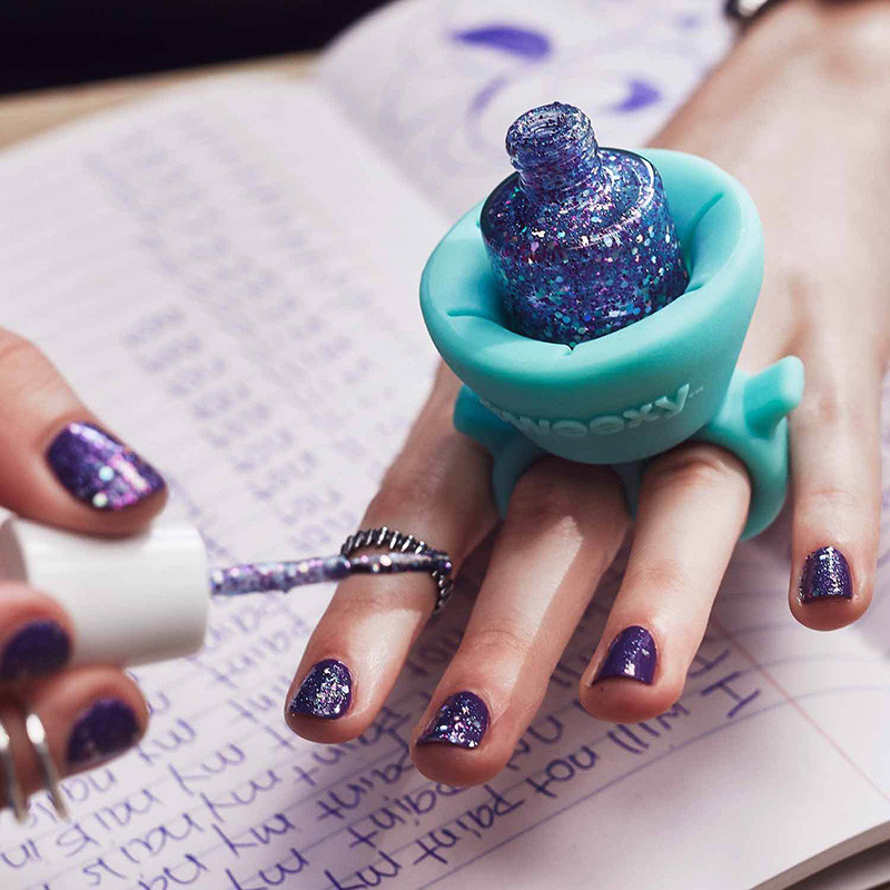 The Design Of This New Wearable Nail Polish Holder Makes Painting