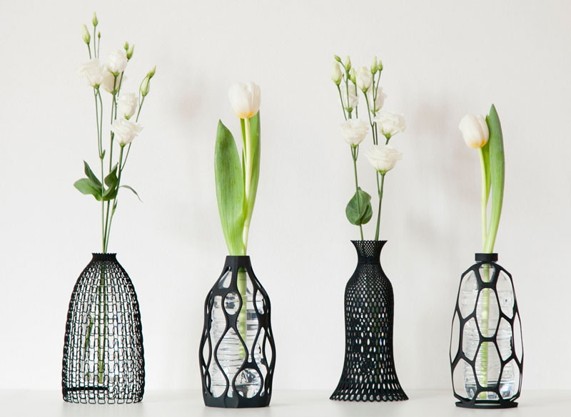 These sculptural vases are designed to use an old plastic bottle inside them
