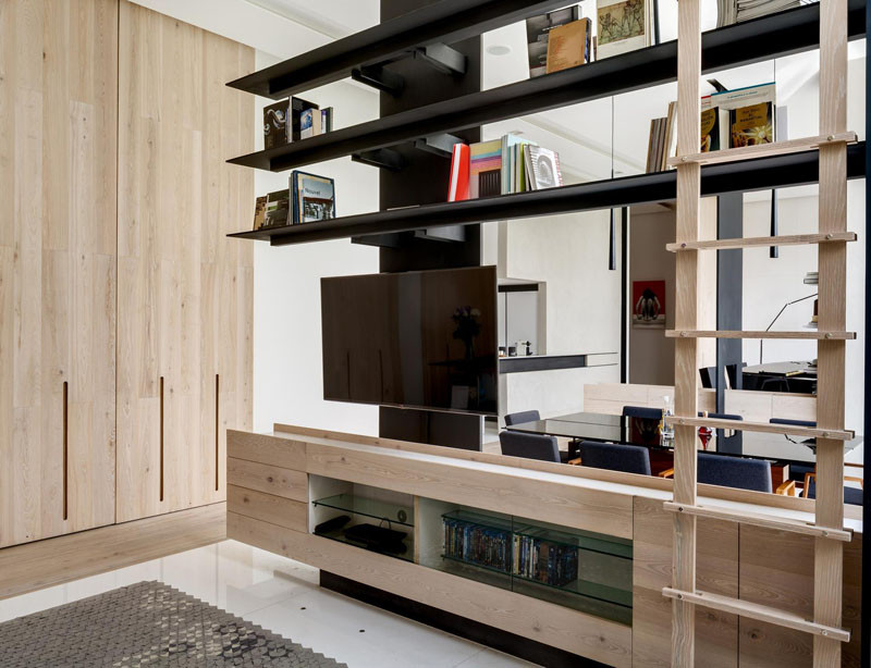 See how this apartment has the living area divided into three defined spaces without the use of walls