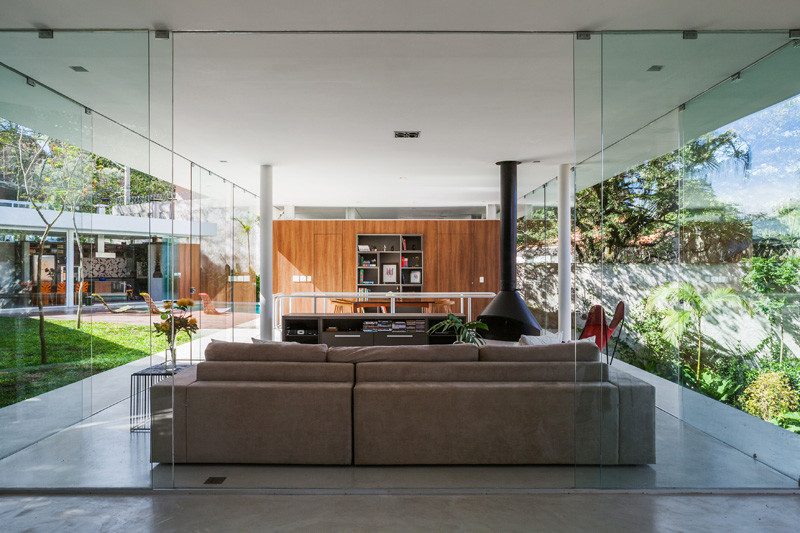See inside this home with glass walls built around a central courtyard