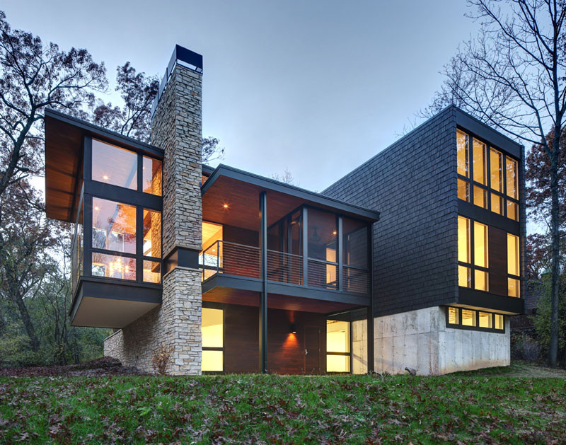 a new contemporary house in wisconsin is covered in stone
