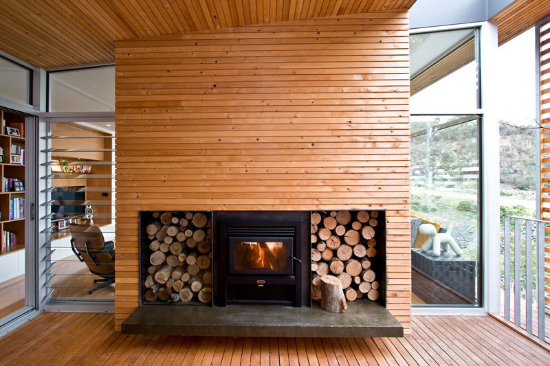 14 inspirational ideas for storing firewood in your home contemporist. Black Bedroom Furniture Sets. Home Design Ideas
