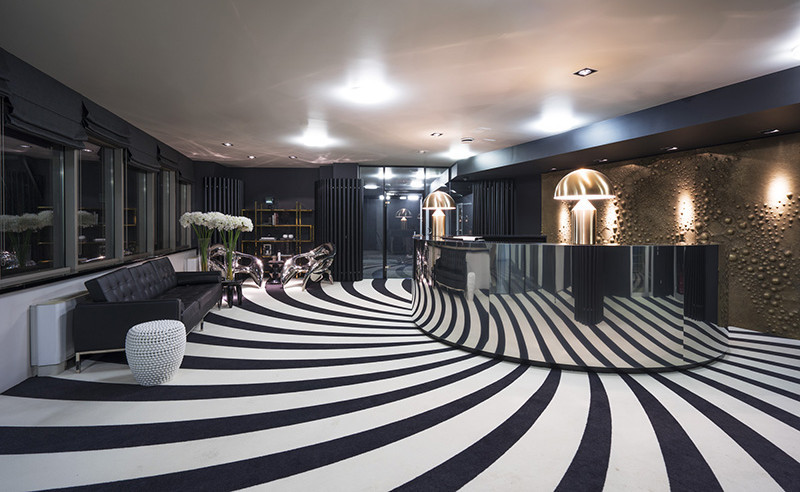 A Hypnotic Carpet Covers The Floor Of This Reception Area