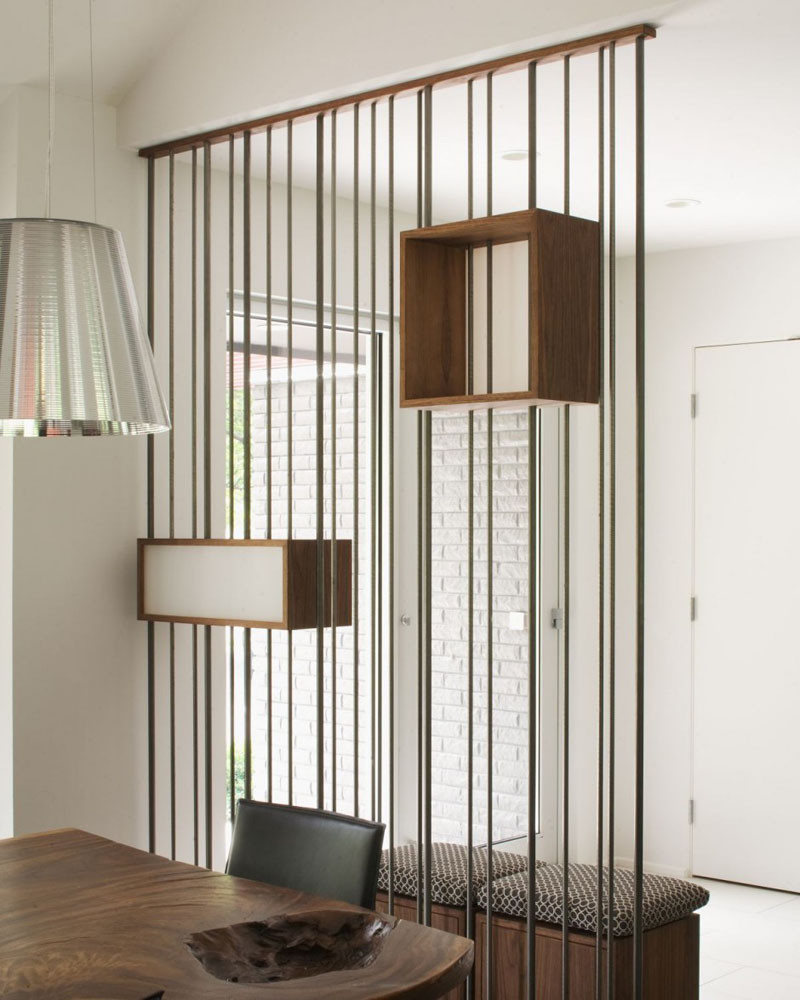 Design Detail - Metal Rods & Wooden Boxes Have Been Used To Create A Partition Wall