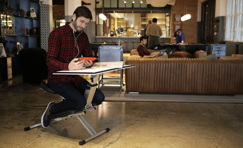 The Edge, a foldable ergonomic desk/chair/easel combo.