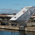 A dramatic sculptural viewing tower is a new landmark for this harbor in Denmark
