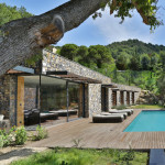 This stone covered home is nestled into an Italian hillside