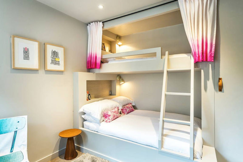 Epic These neutral colored bunk beds with a touch of pink are in a home in Edinburgh