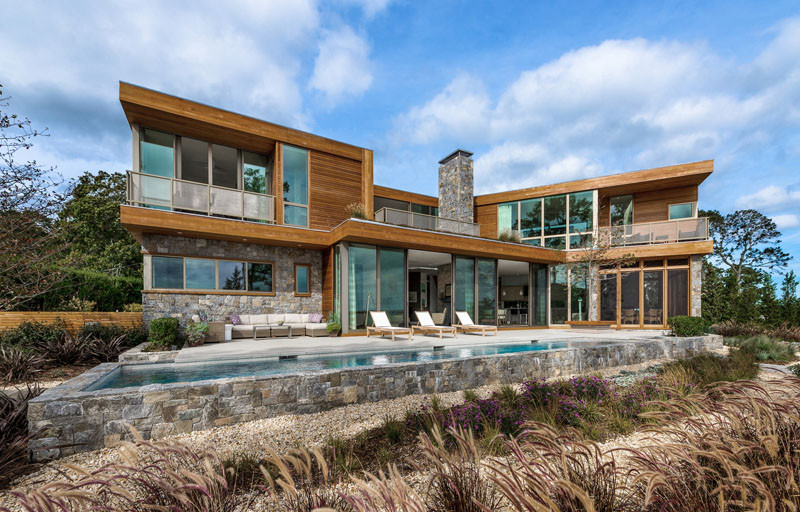 This wood and stone house overlooks the New York coastline