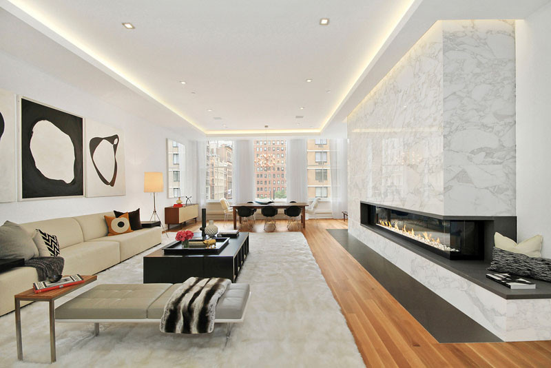 Illuminated drop ceilings emphasize the height inside this New York apartment