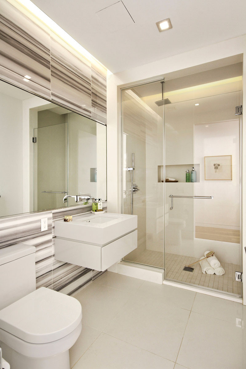 Apartments inside bathroom - Illuminated Drop Ceilings Emphasize The Height Inside This New York Apartment