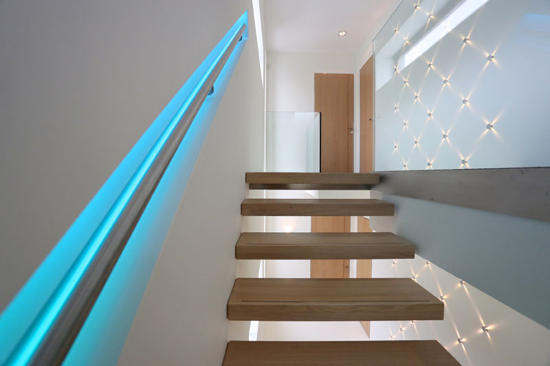 This staircase handrail has been designed to change colors using LED lights.
