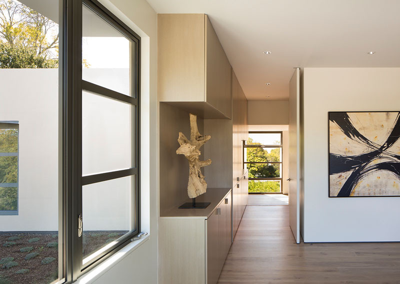 Built-in cabinetry adds extra storage in the hallway of this modern house. #Hallway #Storage #Cabinets