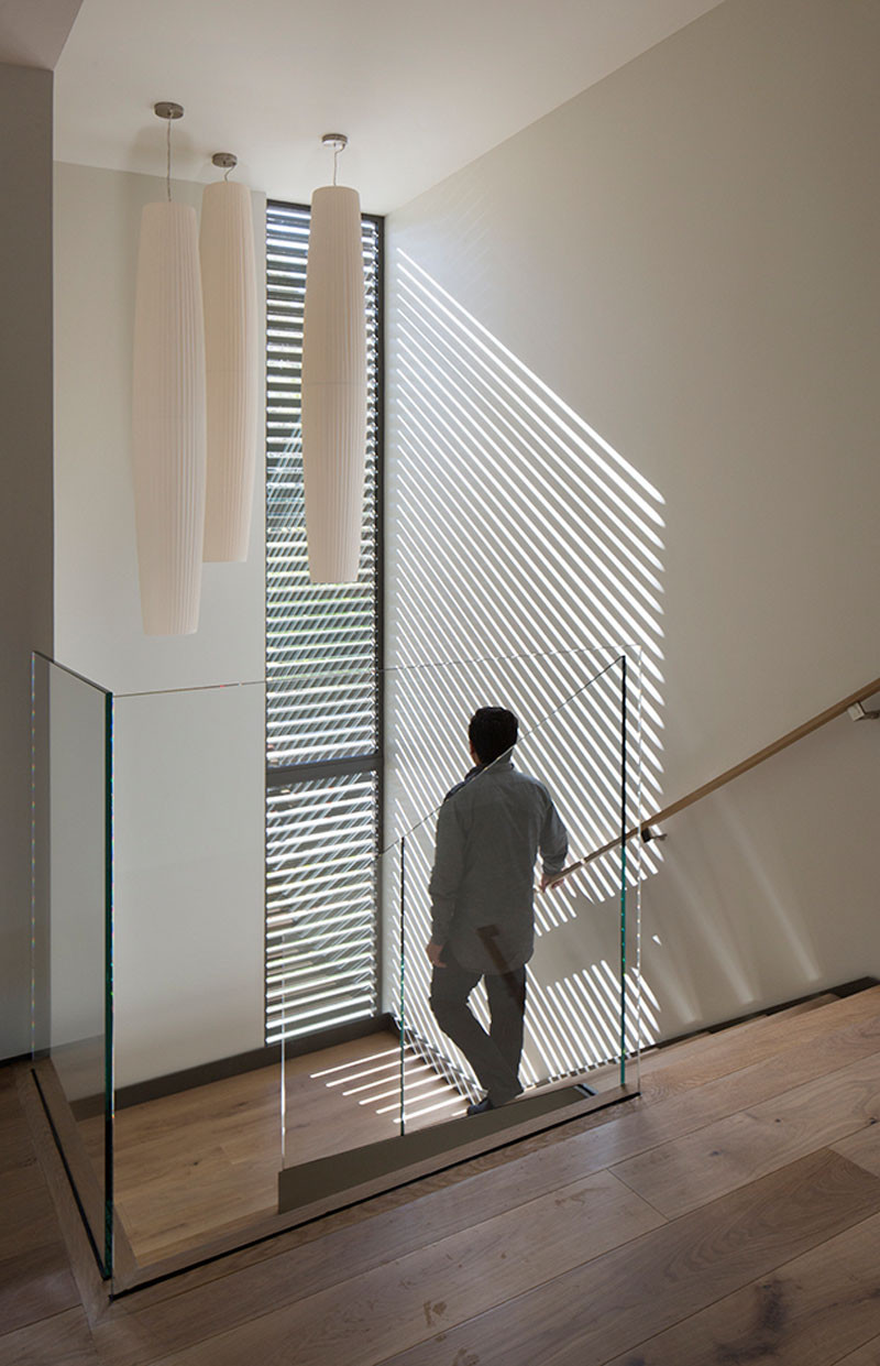 At night, this screen emits horizontal stripes from the stairwell's lighting, creating a lantern effect seen by anyone on the exterior of the home. #Windows #Screens #Stairs