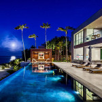 This modern home in Malibu includes plenty of palm trees and ocean views