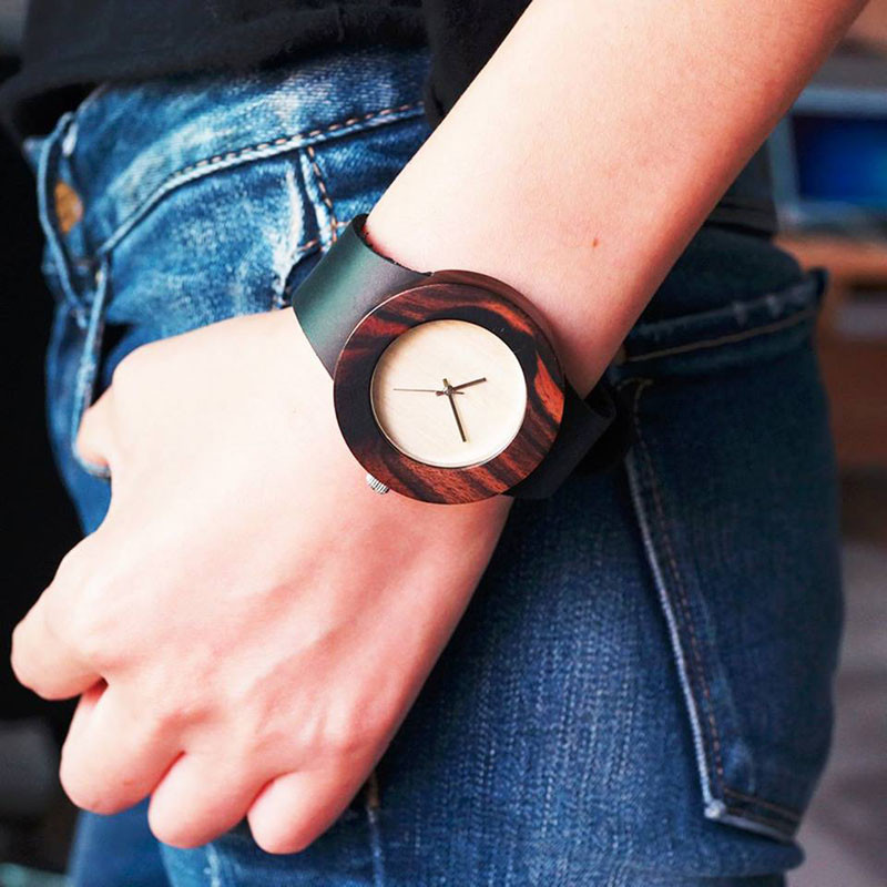 A modern ebony wood watch with a black leather strap. #ModenWoodWatches #Style #WoodWatches #Watches