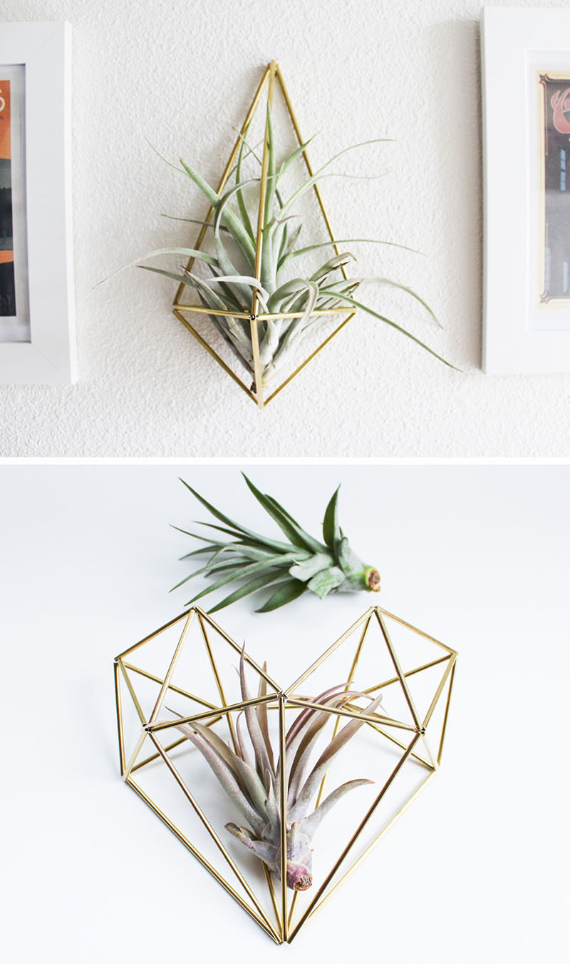 "12 Elegant Ways To Bring Air Plants Into Your Home // These brass air plant holders, also known as a ""himmeli"", are a great way to add some art to your wall, while housing your air plant as well. #AirPlants #ModernHomeDecor #Planters #ModernDecor"