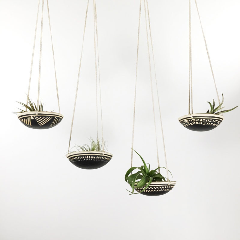12 Elegant Ways To Bring Air Plants Into Your Home // These monochromatic hangers display your air plants from the ceiling. #AirPlants #ModernHomeDecor #Planters #ModernDecor