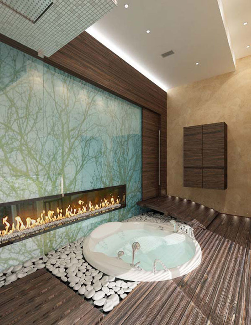 This bathroom includes a fireplace and white pebble stones.
