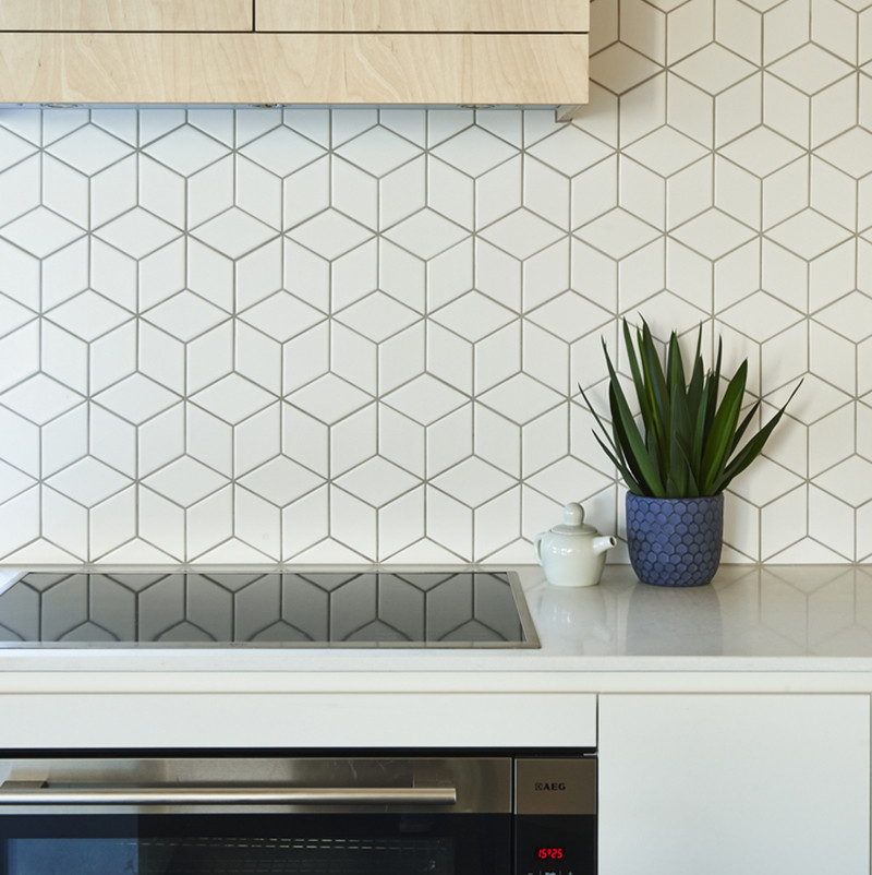 Tile is one of the most popular backsplash options out there. It's simple to install, easy to maintain, and comes in a huge range of colors, shapes, and sizes making it perfect for people who want to express their creativity in the kitchen. #TileBacksplash #KitchenBacksplash #KitchenDesign #BacksplashIDeas