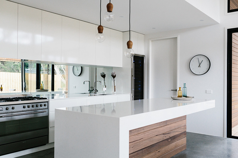 Mirrored backsplashes are popular largely in part because of their affordable price point. They're also easy to clean, brighten up the space they're in, make the room appear larger than it is, and act as a unique design feature. #MirroredBacksplash #KitchenBacksplash #KitchenDesign #BacksplashIDeas