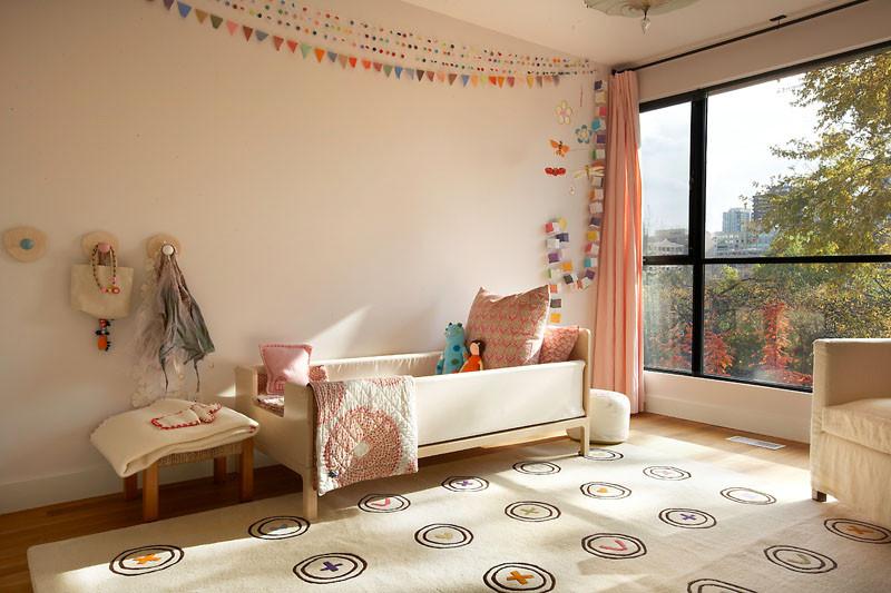 This rug has a button design with colored threads. #KidsRug #ColorfulRug #ModernRug #NurseryRug