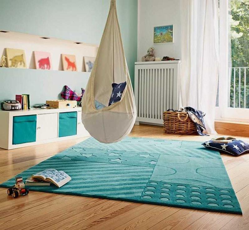 This solid teal blue stars and stripes rug adds a bold pop of color. #KidsRug #BlueRug #ColorfulRug #ModernRug #NurseryRug
