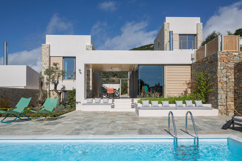 Built-in benches with cushions provide extra seating around the pool.