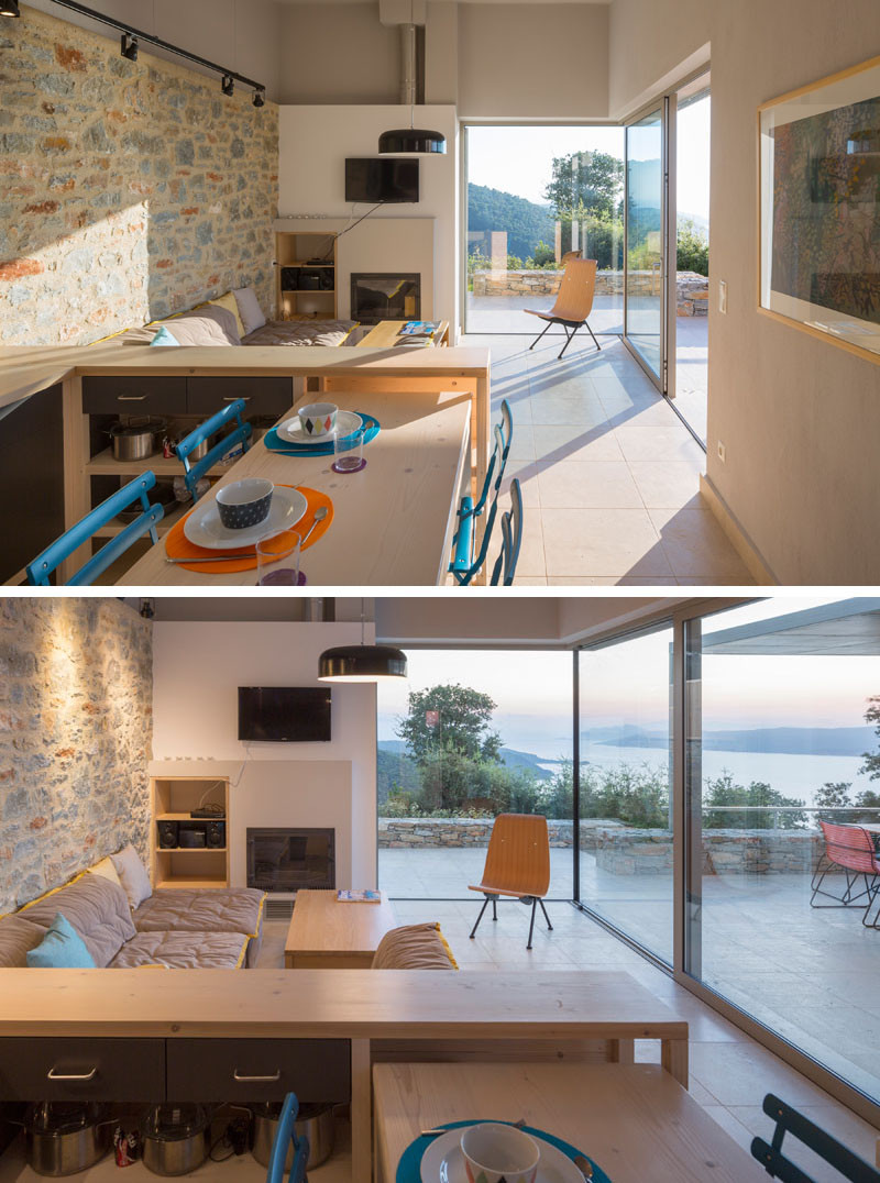 This living / kitchen area has floor-to-ceiling windows with picturesque sea views.