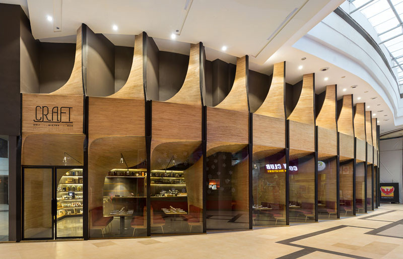 Sculptural Wood Elements Flow From The Exterior To The Interior Of Beauteous Exterior Restaurant Design