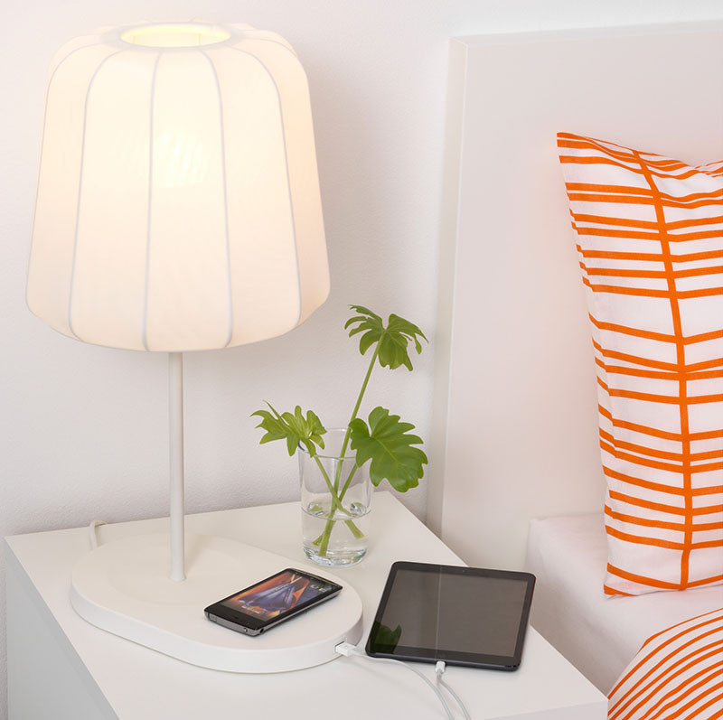 14 Guest Room Essentials To Make Sure Your Visitors Feel At Home // With everyone traveling with a phone, tablet and even a laptop, provide a spot for them to charge their device. Some lighting and furniture already have wireless charging capabilities to make it an easy option to add to your guest room. #GuestRoom #GuestRoomIdeas #GuestRoomEssentials