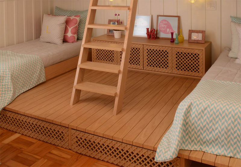 This cute little girls bedroom has a lofted playspace